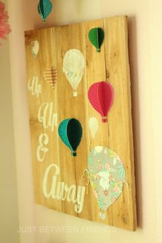 DIY hot air balloon art. Would be adorable if guests signed balloon pieces for a going away party!