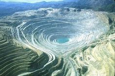 Bingham Canyon Mine, Utah, USA, is the biggest open pit mine and the largest, deepest human excavation in the world. It was started in 1906 and is now 1 mile deep, 2.5 miles wide and covers 1900 acres. It processes 456,000 yards/day & generates 18 million tons of copper, 400,000 oz of gold, 4 million oz of silver and 20 million tons of other minerals every year. It is by far the most important mining operation in the US, generating 2 billion dollars yearly, more than every other mine…