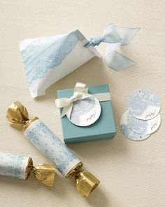 For elegant and easy favors, use our lace clip art to package goodies. Stuff cotton candy into white favor bags folded into a bold new shape and imprinted with an intricate lacy pattern. For the cracker favors, we filled a number of clear acetate tubes with assorted candy, wrapped them in gold tissue paper, and topped them off with our clip art.