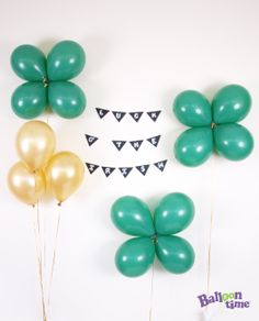 Four-leaf clover #DIY: Take two balloons and tie together, then add in an additional two to form a clover pattern using ribbon to secure.