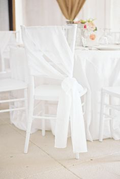 Fabric-wrapped reception chairs in Hogansville, GA. MyLife Photography. More: http://www.theknot.com/weddings/album/a-simple-modern-wedding-at-victoria-belle-mansion-in-hogansville-georgia-171904