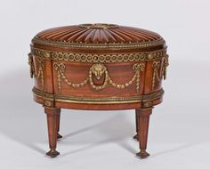 it is one of the best antique from chippendals collections.it is a sideboard suite for dining table.Ornate wine cooler designed for Harewood  by chippendale . its wine colour and sculptures carft work on it make it master piece. there is a golden unique pattern work around the table .