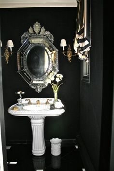 Black walls, black floor.  Only for a small powder room as it would be a nightmare to clean as a fully functional bathroom.