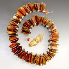 Evelyn Markasky: Like a Moth to a Flame - finished neckpiece.  copper, enamel, turquoise and coral beads, folded, formed, torch-fired.