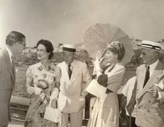 Consummate hostess Marjorie Merriweather Post, with parasol, greets the just-arrived Duke and Duchess of Windsor, to her right.