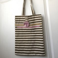 "Striped French Striped Tote Adorable handmade brown and tan striped long tote. All cotton adorned with textural decoration and a pink leatherette rose. So cute!!! 11"" across and 166"" bucket tote with 10"" handles. One of a kind Bags Totes"