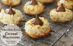 These Chocolate Kissed Coconut Macaroons are more cookie like than standard macaroons. Each has a chocolate kiss in the center for the ultimate coconut and chocolate treat.