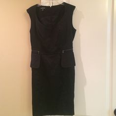 Cocktail dress Cute black cocktail dress with mock zipper pockets on the side, fully lined , only worn a couple times. bebe Dresses Midi