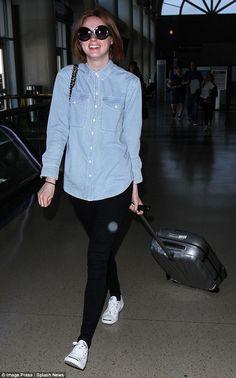 Keeping it casual:Former Doctor Who star Karen Gillan wore a denim shirt, black skinny je...