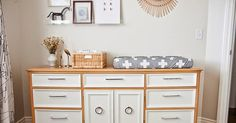 Acrylic shelves to display artwork and a freshly painted dresser as a changing table! This nursery has tons if great diys