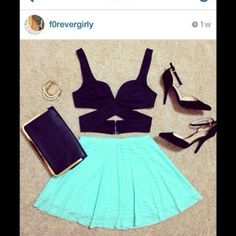 sexy black bustier and tosca flare skirt. cute one :)