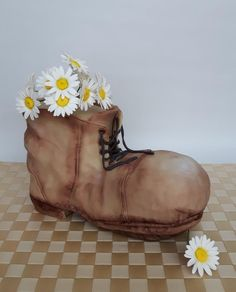 Old shoe with flowers by Olina Wolfs