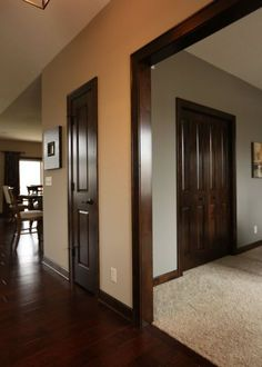 How to update the look of dark wood trim with modern paint colours such as Comfort Gray and Revere Pewter