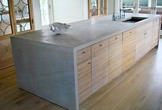 grey benchtops, bleached wood cupboards, kitchen island, underbench mounted sink