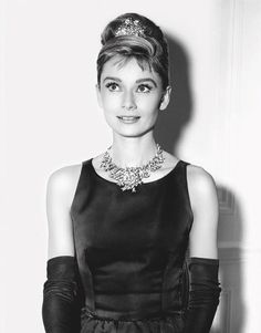 Audrey Hepburn posing in the Schlumberger Ribbon Rosette Necklace set with the Tiffany Diamond. Photo Audrey Hepburn ™ Trademark and Likeness property of Sean Hepburn Ferrer and Luca Dotti – All Rights Reserved