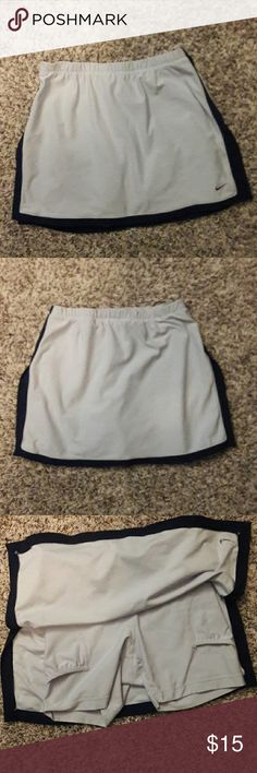 NIKE  SKORT/SKIRT Like new. SKIRT with shorts under. DRI fit. Light blue and black. Pull on and comfy.  Size XS (0-2) Nike Skirts