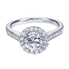 ER7278 is a beautiful Channel Set Halo Engagement ring, set with Round Brilliant Diamonds down the shank and around the halo. This ring can set a 6.50mm Round Brilliant Center stone and has band width of 2.00mm. This ring is available in Available in Yellow Gold, White Gold, Rose Gold or Platinum.