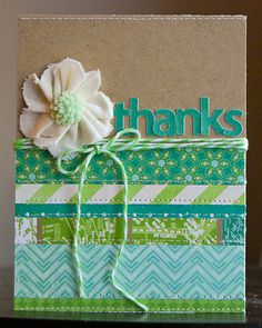 Pretty card idea using paper scraps, cut out letters, and rosettes.