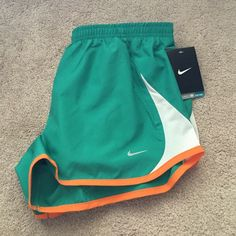 NWT Nike size medium shorts New with tags green/teal Nike shorts. Size medium. Shorts have the underwear like lining on the inside Nike Shorts