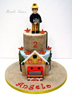 Fireman Sam inspired cake for little Angelo's birthday! Bottom tier I wanted to include the fire station and. Fireman Sam Cake, Fireman Party, Fondant Cakes, Cupcake Cakes, Thomas Birthday Cakes, 3rd Birthday, Birthday Ideas, Fire Engine Cake, Fire Cake