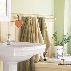 Top wainscot with a peg rail, rather than a wood cap, for a charming way to hang bath towels.   Photo: Dominic Blackmore/IPC Images   thisoldhouse.com