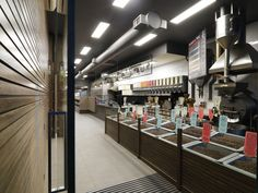 The Coffee Company | Retail design concept hinges around a 50's industrial style, integrating historical elements such as suspended cast iron light fittings sourced from the…