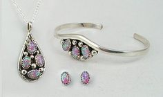 Opal changes color depending on how the light hits it - these change from green to deep rose.