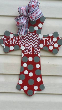 Check out this item in my Etsy shop https://www.etsy.com/listing/451647990/alabama-crimson-tide-wooden-cross