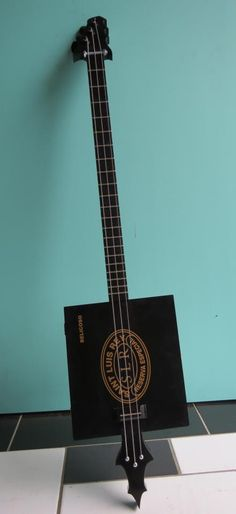 "Black Dragon (cigar box guitar) - lovingly crafted by a carpenter/musician. Stunning. Check out ""Mr W's Handmade Instruments"" on Facebook"
