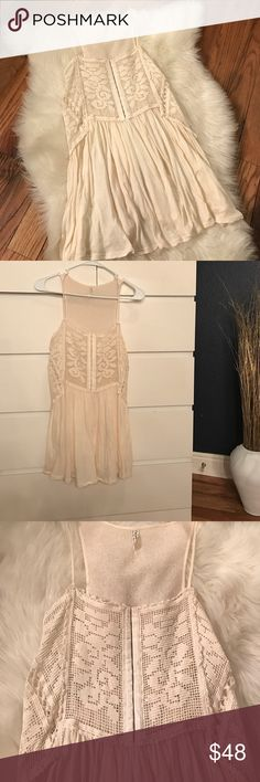 Free People Greenhouse Rose Tank Free People Greenhouse Rose Tank  Crochet detailing all around top & midsection   13 bustier like clasps in the front   Unique crochet pattern in front, goes into a deep v on the sides, and is solid material in back  Skinny shoulder straps   Soft and flowy bottom   Polyester and cotton   Can definitely be worn as a mini dress if body type allows - I am 5'1, 00, 32B and I wore it as a dress!  Makes for a versatile look as either a Tank or mini dress Free…