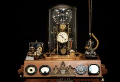 Mounted on top/left are a Westinghouse glassed enclosed voltage relay w/small lamp installed, a cat whisker crystal radio receiver pick-up, a horizontal mounted steam engine connected to an early model aircraft gas engine.