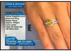 Yellow sapphire and diamond ring - from our estate collection. A 3ct yellow sapphire set in 18k white gold with diamond accents.