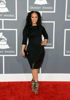 "Erica Campbell from gospel group mary mary, Showed off her curves in this black body con dress . Can you say ""sassy chic"""