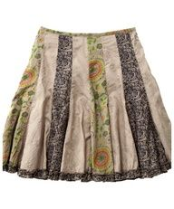 Upcycled skirt cut into strips with companion fabric strips added in...super cute.