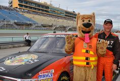 Bobber the water safety dog and driver Jeff Agnew .  The Jacksonville District, U.S. Army Corps of Engineers and Bobber the Water Safety Dog mascot teamed up to promote water safety at the NASCAR Camping World Truck Series Ford EcoBoost 200 race at Homestead-Miami Speedway.
