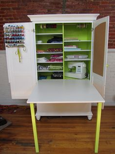 Sewing armoire with fold out desk, ribbon holders, thread spool holder, adjustable shelves, cork board and internal electrical outlet!