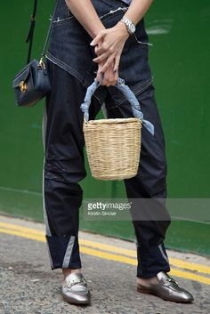 Trend forecaster Kelly Harrington wears Hannah Jinkins jeans, Tods shoes, Prada bag and Blooming Dreamer basket day 3 of London Womens Fashion Week Spring/Summer 2017, on September 18, 2016 in London, England.