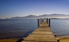 """""""I grew up on one of the most beautiful lakes in the USA, Lake George. We did not go anywhere during the summer because we hung out with our friends swimming, water skiing, sailing, and doing any other water-related activity we could think of, camping on an island, watching the fireworks on the 4th from our boat, etc. Many fond memories!""""Connie Martin (Teconley/Dreamstime) (From: 33 Ultimate Summer Vacations!)"""