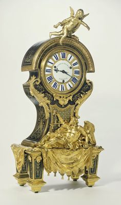 Mantel Clock (Pendule), Movement maker Paul Gudin (French, active about 1729 - 1755), Case attributed to André-Charles Boulle, about 1715 - 1725, Oak veneered with tortoise shell, blue-painted horn, brass, and ebony; enameled metal; gilt bronze mounts
