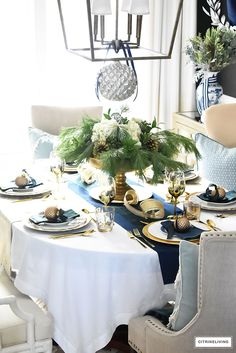 Gorgeous Christmas tablescape with classic navy and green tartan, accented with gold ornaments, chargers, flatware and glassware. Blue Christmas Decor, Tartan Christmas, Gold Christmas Decorations, Christmas Tablescapes, Gold Ornaments, Christmas Home, Christmas Ideas, Christmas 2019, Christmas Crafts