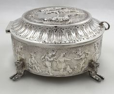 """English antique silver circular box with chased figures London 1835 by Edward and John Barnard. Dia. 7.5"""", height 4""""."""
