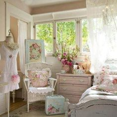A very feminine bedroom...soft and romantic.