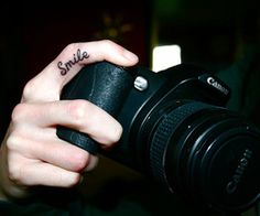 smile!  Now THAT'S a tat for a photographer!