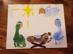 Manger scene with footprints and handprints...