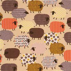 Tissu Oxford couleur havane clair avec des moutons aux motifs multicolores