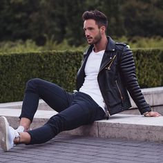 Busy days call for a simple yet stylish outfit, such as a black quilted leather biker jacket and dark blue pants. Finish off this look with white low top sneakers. Shop this look on Lookastic: https://lookastic.com/men/looks/black-biker-jacket-white-crew-neck-t-shirt-navy-chinos/18408 — White Crew-neck T-shirt — Black Quilted Leather Biker Jacket — Navy Chinos — White Low Top Sneakers