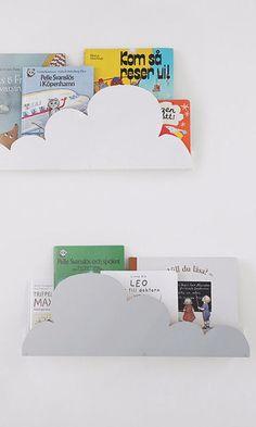 Corral children's books on floating shelves from IKEA.