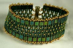 Tila and seed bead bracelet. This is falls into the simple yet striking category.  Love the tila color with gold seed beads.  http://www.beadjungle.com/img/0812Tila_Trellis.jpg