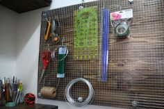 """Pegboards are amazing for small spaces but I've just never liked the look of them. It's all those holes, they make me think of dust and wonder if there spiders hiding in them. So when I was looking for a different storage solution for my craft supplies – like that damn rotary cutter I can … Continue reading """"DIY Pegboard for Craft Room Storage"""""""