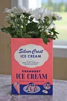 vintage ice cream box with a planted flower placed inside!!  cute!!